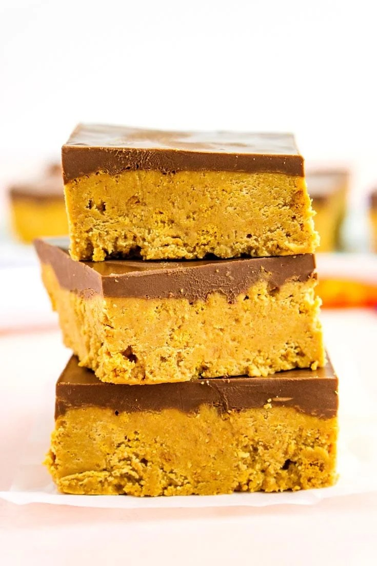 A stack of chocolate peanut butter bars stacked on each other.