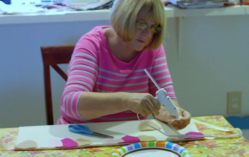 Grandma gluing the leaves for the DIY owl costume