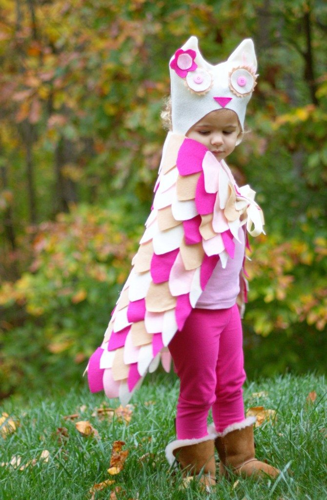 side view of a girl in a DIY owl costume