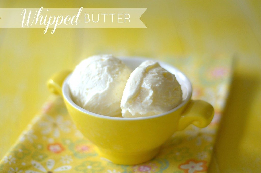 two scoops of whipped butter in a small bowl with text overlay for Pinterest