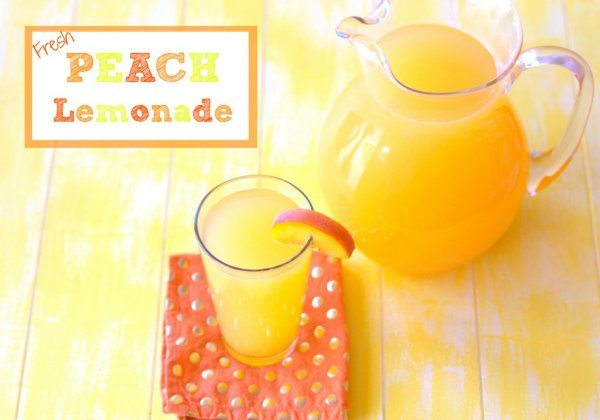 Fresh Peach Lemonade in a glass pitcher and in a drinking glass that is garnished with a peach slice.
