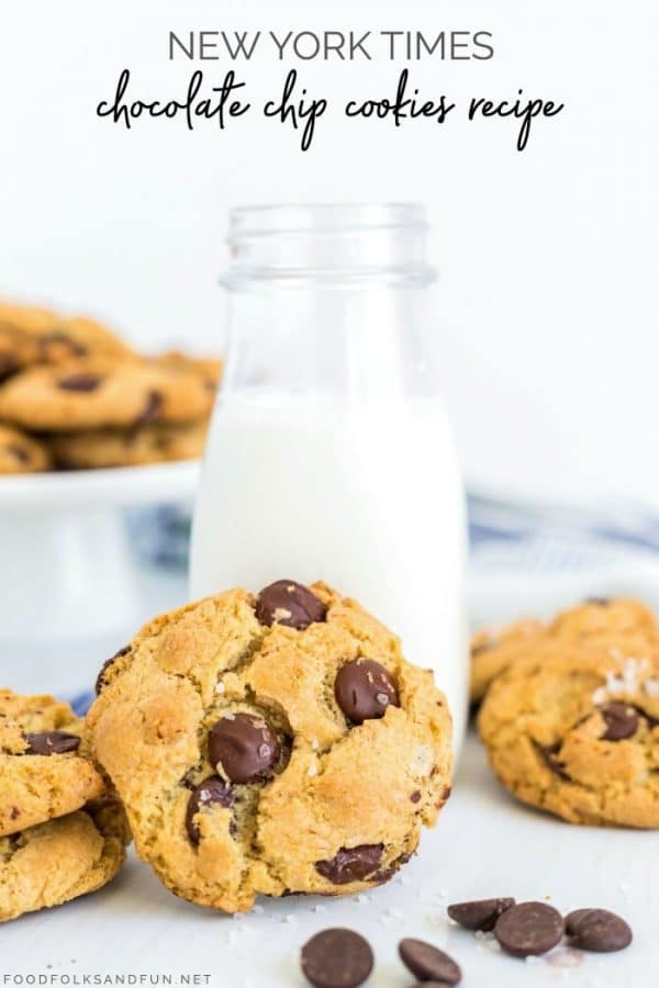 Cookies with a tall class of milk.