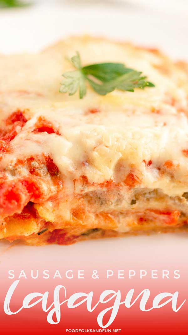 Close up picture of a slice of cheesy lasagna with Italian sausage.