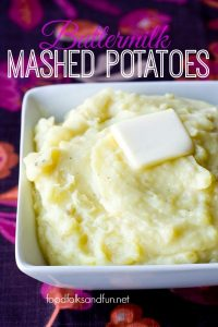 Buttermilk Mashed Potatoes in a white serving bowl with a pad of butter on top.