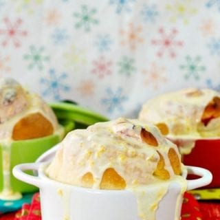 Cranberry Rolls with orange icing in small bowls