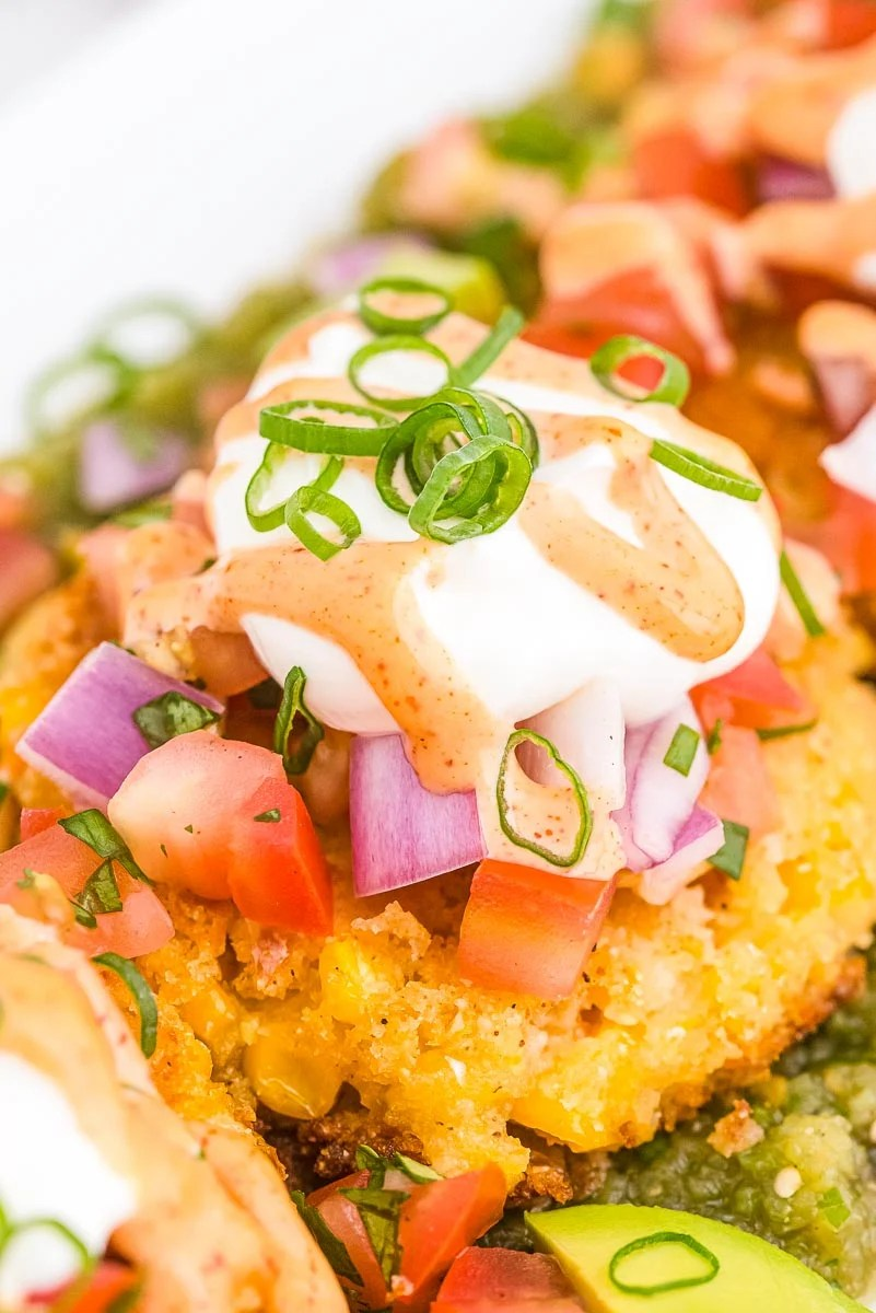 A close up picture of the copycat Sweet Corn Tamale Cakes on a white platter.