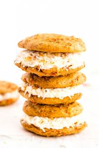 Carrot Cake Whoopie Pies filled to the brim with Coconut Cream Cheese Frosting