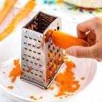 This is how you grate carrots with a box grater.