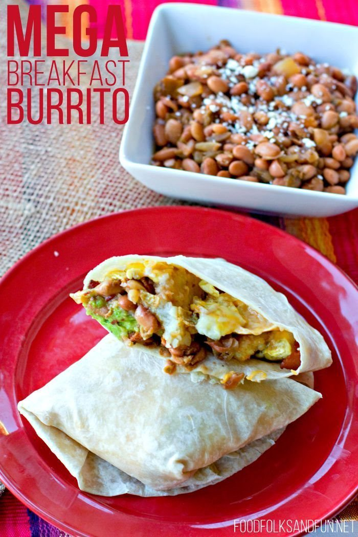 Breakfast Burrito on a plate with pinto beans on the side with text overlay for Pinterest
