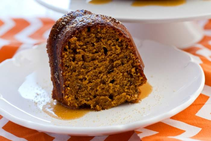 A slice of pumpkin honey cake on a white plate.