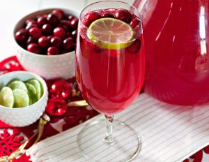 Make this Cranberry Limeade Sparkling Cocktail for your next holiday party. It's to perfect festive mocktail for Christmas and New Year's!