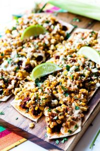 Mexican Street Corn Flatbread Pizza is an easy, crowd-pleasing appetizer for summer entertaining! It's everything you love about street corn but in a tasty flatbread bite! Plus you can make this recipe in 30 minutes or less!