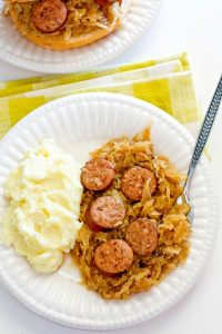 A serving of Kielbasa Kapusta with mashed potatoes on the side
