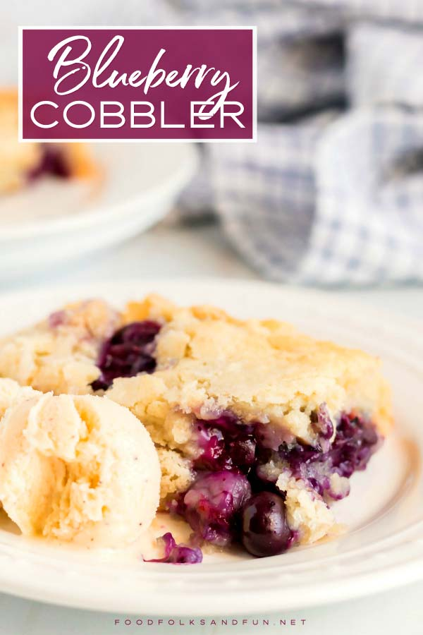 Fruit cobbler on a plate with rice cream.