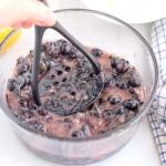 Smash the blueberries with a potato masher.