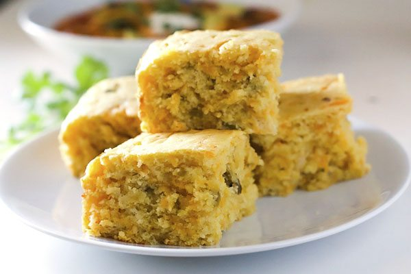 My all-time favorite cornbread recipe gets an update with the addition of sharp cheddar cheese and chopped green chiles. This Cheesy Green Chile Cornbread is the perfect cornbread for early fall and green chile season!