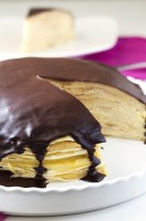 This Boston Cream Pie Crepe Cake has layers of sweet crepes between layers of silky pastry cream that's topped with a smooth chocolate glaze. Basically it's the crepe cake of your dreams!
