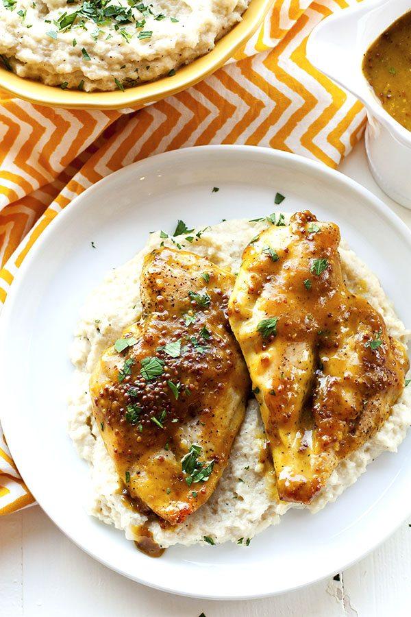 Honey Mustard Chicken on a plate with mashed cauliflower.