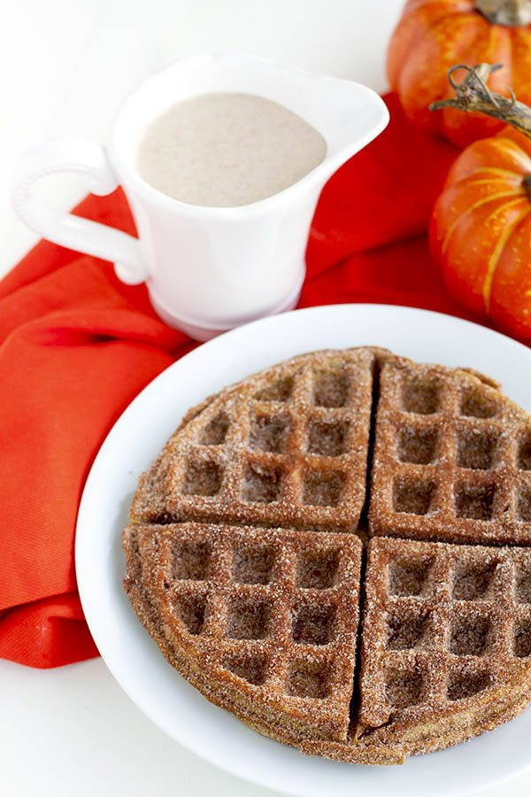 These Pumpkin Churro Waffles are crisp on the outside and creamy on the inside; almost soufflé like. They're coated with spiced sugar and drizzled with a spiced cream cheese glaze.