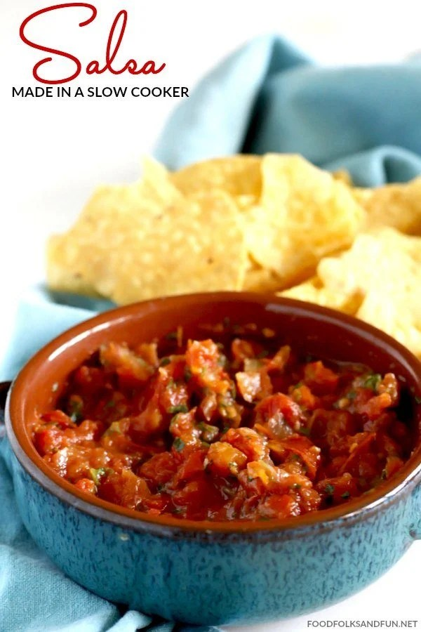 Slow Cooker Salsa in a bowl with a bowl of chips