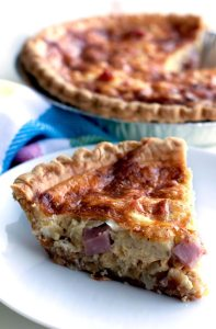 This easy ham and cheese quiche recipe has a creamy smooth custard interior, and it's filled to the brim with ham and Swiss cheese. It's perfect for breakfast, brunch, lunch, or dinner!