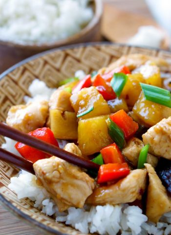A close-up of Sheet Pan Stir-Fried Chicken Teriyaki in a bowl