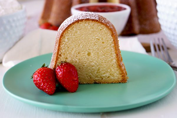 This Cream Cheese Pound Cake is rich, tender, buttery, and it has a slight tang from the cream cheese. This cake is delicious on its own or utterly amazing served with Fresh Strawberry Topping!