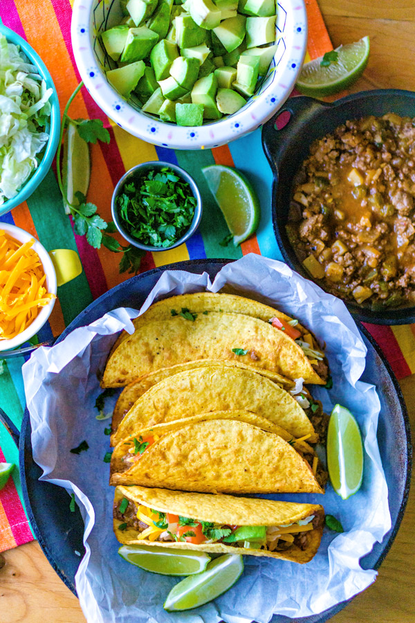 Overhead picture of tacos with all of the toppings.