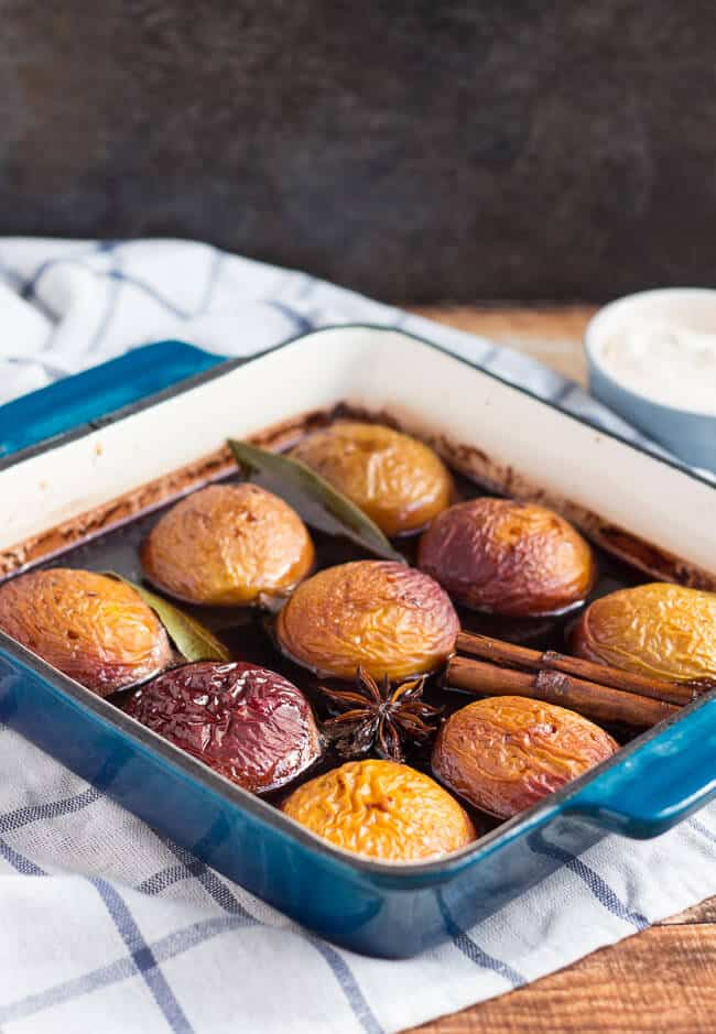 Oven Roasted Nectarines in Red Wine in a square baking dish