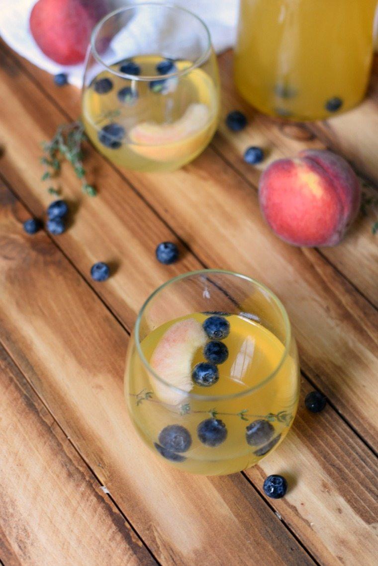 A glass of Peach Blueberry Sangria
