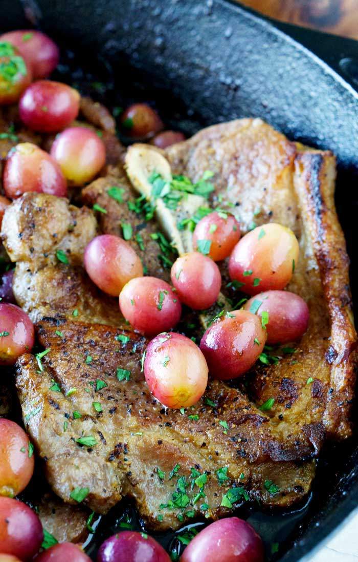 Making pork chops in a cast iron skillet.