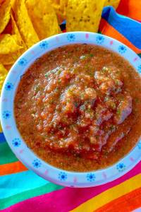 Overhead picture of blender salsa in a white bowl.