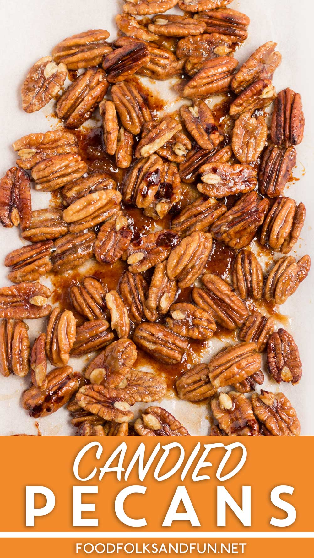 Candied pecans on a serving platter with text overlay for Pinterest