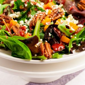 A close up picture of Thanksgiving Salad in a white bowl.