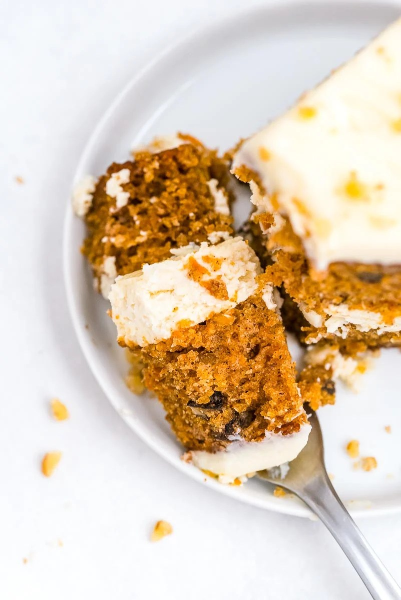 A close up picture of some Cheesecake Factory Carrot Cake Copycat on a fork.