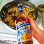 Add the Sherry and simmer with the shallots.