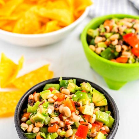 Dip made with black eyed peas, bell peppers, green onions, celery, and fresh herbs.