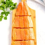 Using a paring knife, cut the salmon fillets into 4 equal pieces.