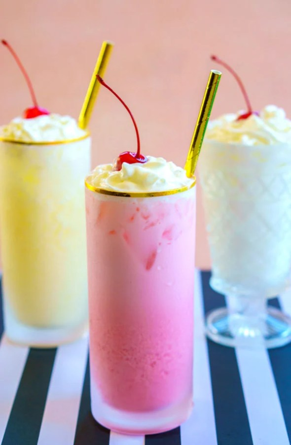 Cherry, pineapple, and coconut Italian Cream Sodas in frosted glasses.