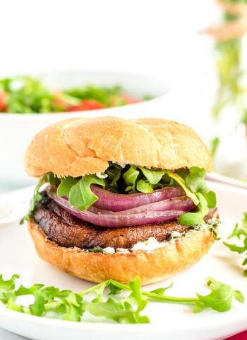 Portobello Mushroom Burger on a white plate with arugula.
