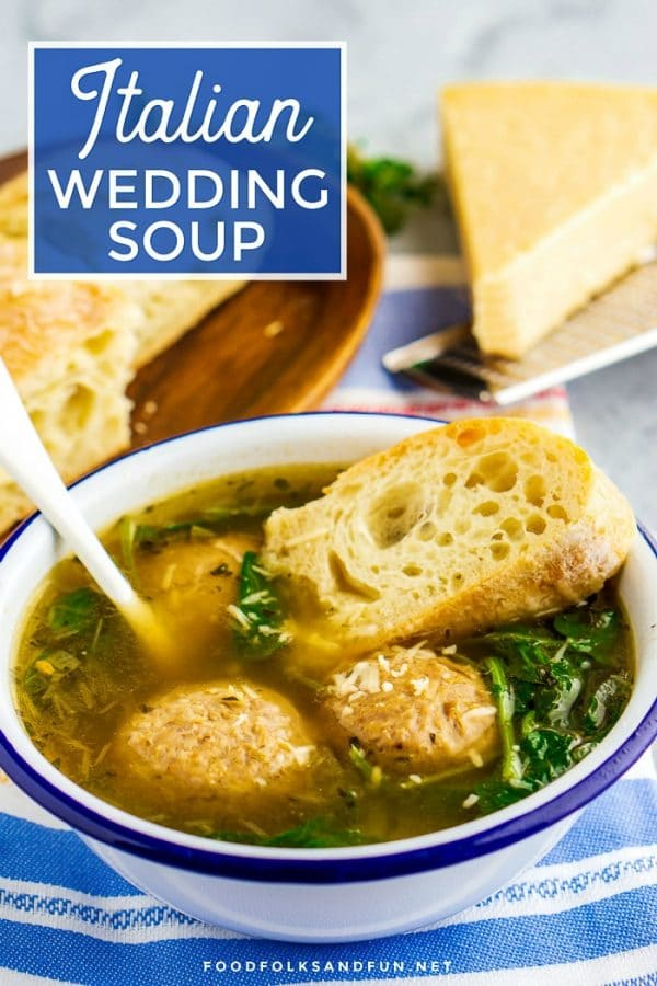 Wedding Soup in a white bowl with bread and Parmesan with text overlay for Pinterest.