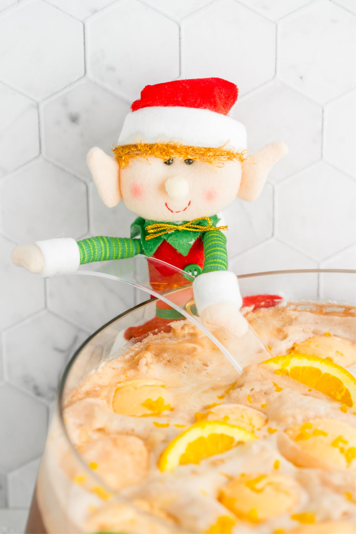 This easy non-alcoholic Christmas Punch recipe is always a party favorite. All you need are just 4 simple ingredients and a large punch bowl! via @foodfolksandfun