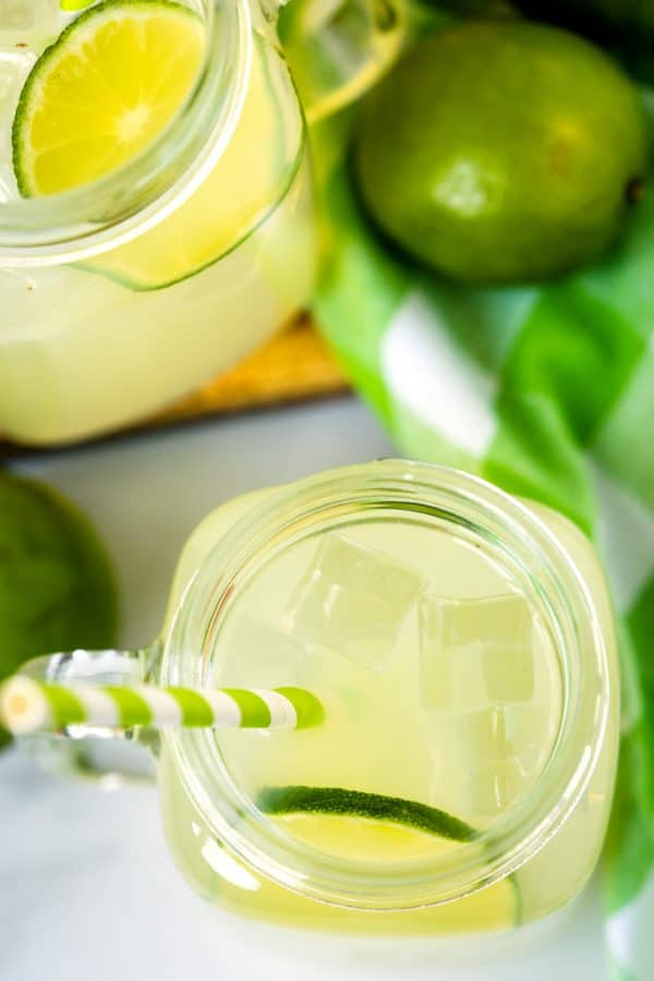 Overhead picture of the finished limeade in a mason jar mug.