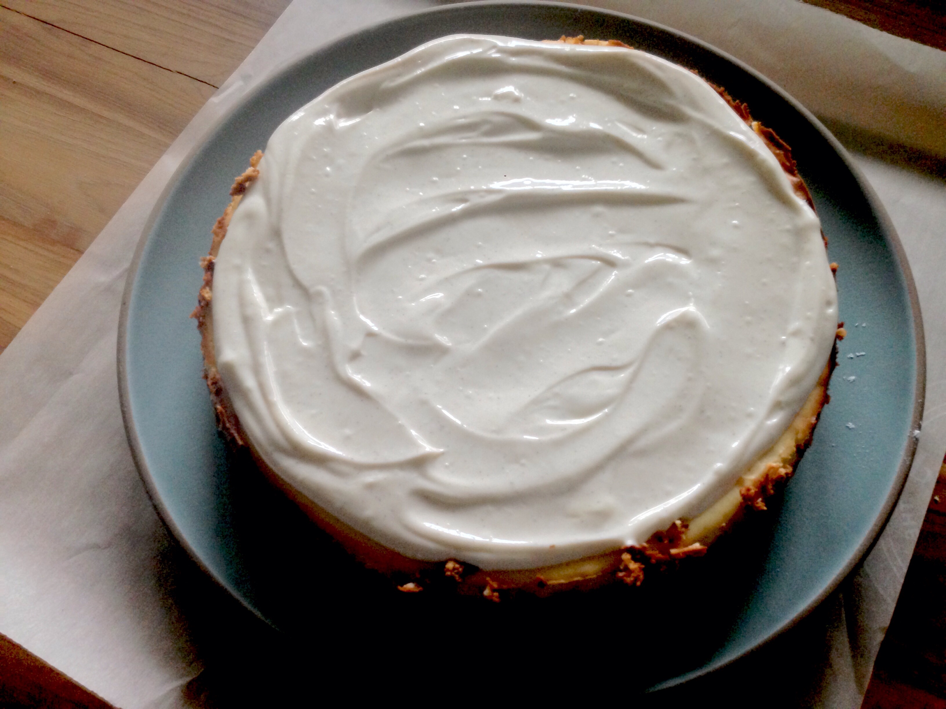 Simple, No-Fail Authentic Vanilla Bean Cheesecake with a Sweetened Vanilla Bean Sour Cream Topping