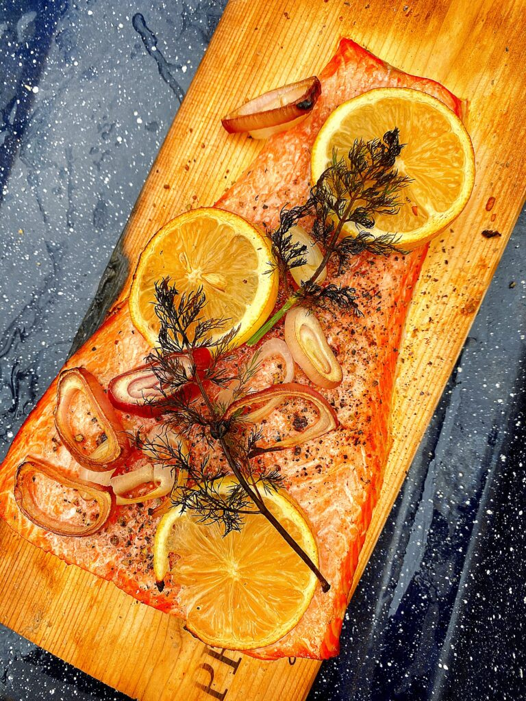cooked trout on plank