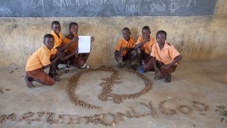 "6th grade students with the symbol ""Only God"""