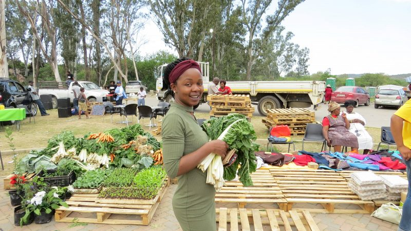 Rhodes University researchers buying produce at the Alice local farmers market