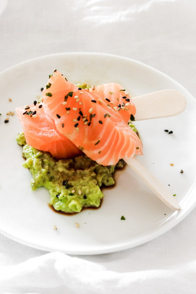 Salmon Sahimi Popsicles with an avocado cream - from front.