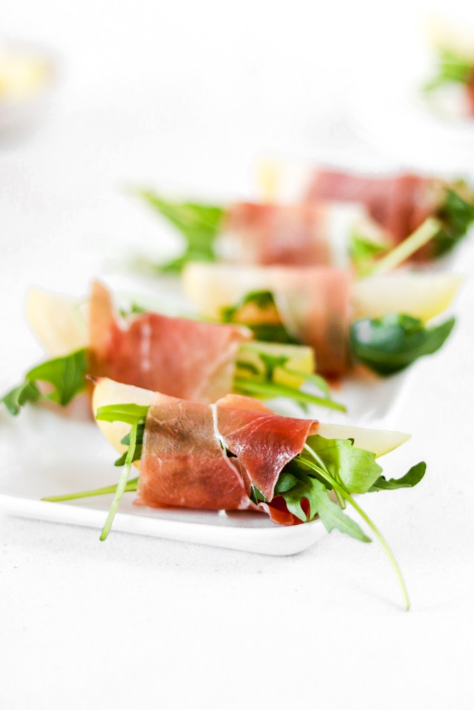 Pear and serrano appetizers with arugula - close up