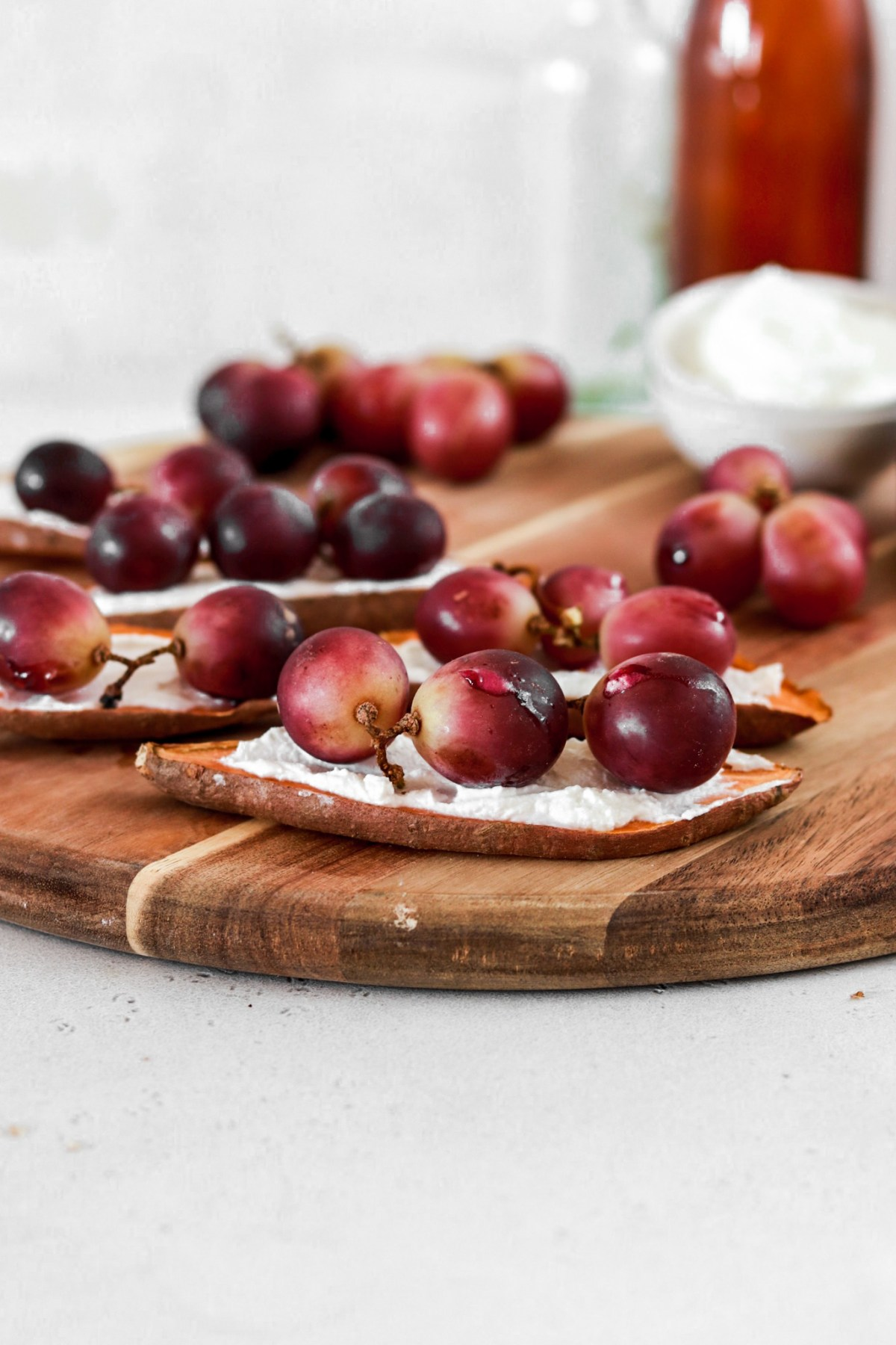 Sweet Potato Toast with Ricotta & Baked Grapes (Gluten & Grain Free) On A Cutting Board